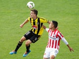 Louis Fenton of the Phoenix wins a header over Iain Ramsay of Melbourne City during the round 17 A-League match between Wellington Phoenix and Melbourne City FC at the Hutt Recreation Ground on February 14, 2015