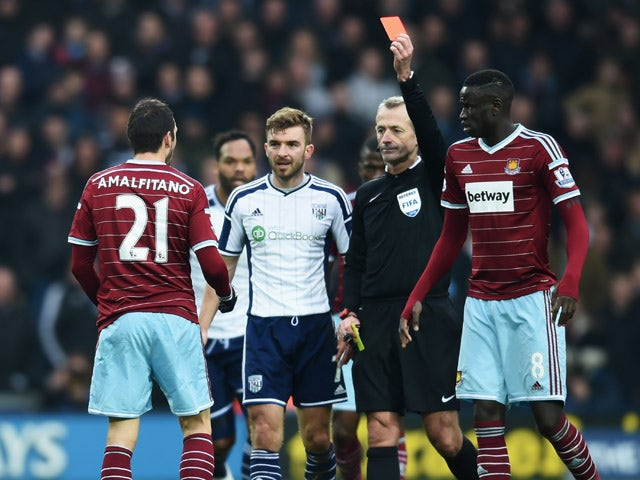 Morgan Amalfitano of West Ham United is shown a red card by referee Martin Atkinson and is sent off during the FA Cup Fifth Round match between West Bromwich Albion and West Ham United at The Hawthorns on February 14, 2015