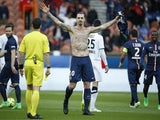 Paris Saint-Germain's Swedish forward Zlatan Ibrahimovic celebrates after scoring during the French L1 football match vs Caen on February 14, 2015