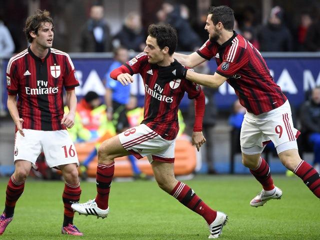 AC Milan's midfielder Giacomo Bonaventura celebrates after scoring during the Italian Serie A football match AC Milan vs Cesena on February 22, 2015