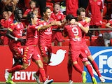 Sergio Cirio of United celebrates with his team mates after scoring during the round 18 A-League match between Adelaide United and Western Sydney Wanderers at Coopers Stadium on February 21, 2015
