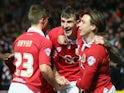 Bristol City players Aden Flint, Luke Freeman and Joe Bryan celebrate the opening goal against Peterborough on February 17, 2015