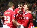 Bristol City players Aden Flint, Luke Freeman and Joe Bryan celebrate the opening goal against Peterborough on February 17, 2015