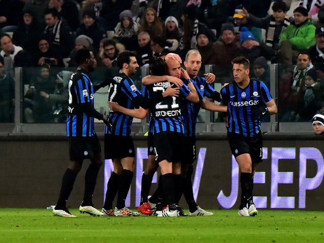 Atalanta's midfielder Giulio Migliaccio celebrates after scoring a goal on February 20, 2015
