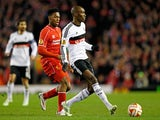 Atiba Hutchinson of Besiktas passes the ball as Daniel Sturridge of Liverpool closes in during the UEFA Europa League Round of 32 match on February 19, 2015
