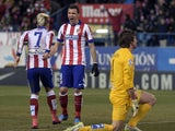 Atletico Madrid's French forward Antoine Griezmann celebrates after scoring with Atletico Madrid's Croatian forward Mario Mandzukic beside Almeria's goalkeeper Julian Cuesta during the Spanish league football match Atletico Madrid vs UD Almeria at the Vic