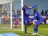 Bastia's French midfeilder Floyd Ayite is congratulated by teammates after scoring a goal during the French L1 football match Bastia (SCB) against Lille (LOSC) on February 21, 2015