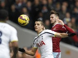 Erik Lamela of Spurs and West Ham's Carl Jenkinson tussle for the ball on February 22, 2015