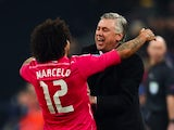 Real Madrid's Italian coach Carlo Ancelotti (R) and Real Madrid's Brazilian defender Marcelo celebrate after Marcelo scored during the last sixteen, first-leg UEFA Champions League match against Schalke on February 18, 2015