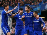 Branislav Ivanovic of Chelsea is congratulated by teammates after scoring the opening goal during the Barclays Premier League match between Chelsea and Burnley at Stamford Bridge on February 21, 2015