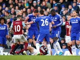 Referee Martin Atkinson shows the red card to Nemanja Matic of Chelsea for his reaction to the tackle by Ashley Barnes of Burnley during the Barclays Premier League match between Chelsea and Burnley at Stamford Bridge on February 21, 2015