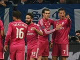 Real Madrid's Portuguese forward Cristiano Ronaldo (R) celebrates with teammates after scoring during the last sixteen, first-leg UEFA Champions League football match against Schalke on February 18, 2015