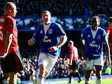 Dan Gosling of Everton celebrates scoring his teams second goal with Louis Saha during the Barclays Premier League match against Manchester United on February 19, 2015