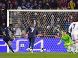 Porto's Brazilian defender Danilo (L) scores a penalty kick past Basel's Czech goalkeeper Tomas Vaclik (2nd R) to equalize during the UEFA Champions League round of 16 first leg football match on February 18, 2015