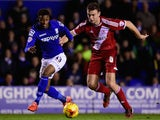 Birmingham forward Demarai Gray (l) is challenged by Middlesbrough defender Ben Gibson during the Sky Bet Championship match on February 18, 2015