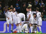 Basel teammates celebrate after Paraguayan midfielder Derlis Gonzalez (Hidden) opened the scoring during the UEFA Champions League round of 16 first leg football match against Porto on February 18, 2015