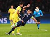 Chelsea's Diego Costa takes down PSG's Thiago Silva on February 17, 2015