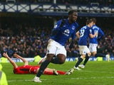 Romelu Lukaku of Everton celebrates as Matthew Upson of Leicester City scores an own goal for their second goal during the Barclays Premier League match between Everton and Leicester City at Goodison Park on February 22, 2015
