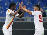 Gervinho (L) with his teammate Daniele Verde of AS Roma celebrates after scoring the opening goal during the UEFA Europa League Round of 32 match against Feyenoord on February 19, 2015
