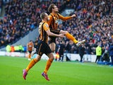 Nikica Jelevic of Hull City celebrates with David Meyler as he scores their first goal during the Barclays Premier League match between Hull City and Queens Park Rangers at KC Stadium on February 21, 2015