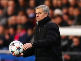 Chelsea manager Jose Mourinho handles the matchball suspiciously on February 17, 2015