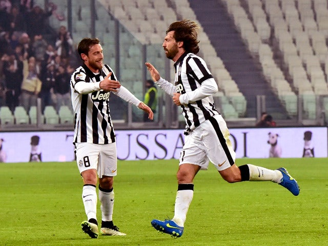 Juventus' midfielder Andrea Pirlo celebrates after scoring a goal with Juventus' midfielder Claudio Marchisio during their Serie A match Juventus vs Atalanta at Juventus Stadium in Turin on February 20, 2015