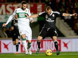 Lomban (L) of Elche competes for the ball with Karim Benzema of Real Madrid during the La Liga match on February 22, 2015