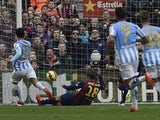 Malaga's Argentinian midfielder Pablo Javier Perez scores a goal during the Spanish league football match FC Barcelona vs Malaga CF at the Camp Nou stadium in Barcelona on February 21, 2015