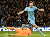 Manchester City's Bosnian striker Edin Dzeko celebrates after scoring his team's third goal during the English Premier League football match between Manchester City and Newcastle at the The Etihad Stadium in Manchester, north west England on February 21,