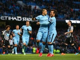 Sergio Aguero of Manchester City celebrates scoring the opening goal from the penalty spot with David Silva of Manchester City during the Barclays Premier League match between Manchester City and Newcastle United at Etihad Stadium on February 21, 2015