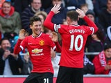 Ander Herrera of Manchester United celebrates scoring the opening goal with Wayne Rooney of Manchester United during the Barclays Premier League match between Swansea City and Manchester United at Liberty Stadium on February 21, 2015