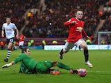 Wayne Rooney of Manchester United draws a foul from Thorsten Stuckmann of Preston North End to win a penalty during the FA Cup Fifth round match between Preston North End and Manchester United at Deepdale on February 16, 2015
