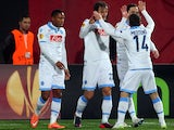 Napoli's Manolo Gabbiadini (L-2) celebrates with his team mates after score a goal during the first-leg round of 32 UEFA Europa League football match against Trabzonspor on February 19, 2015