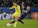 Chelsea's Eden Hazard comes up against PSG midfielder Marco Verratti on February 17, 2015