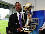 Former West Indian Cricketer, Michael Holding poses with the ICC Cricket World Cup Trophy during the England v India One Day International at The County Ground on August 25, 2014