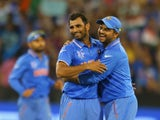 Mohammed Shami of India celebrates with Suresh Raina after dismissing Dale Steyn of South Africa during the 2015 ICC Cricket World Cup match between South Africa and India at Melbourne Cricket Ground on February 22, 2015