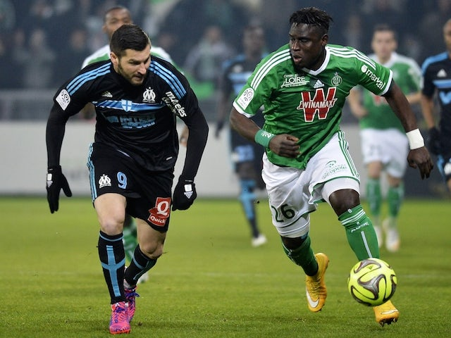 Saint-Etienne's Senegalese defender Mustapha Bayal Sall (R) vies with Marseille's French forward Andre-Pierre Gignac (L) during the French L1 football match on February 22, 2015