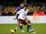 Nenad Tomovic of ACF Fiorentina battles for the ball with Fabio Quagliarella of Torino FC during the Serie A match on February 22, 2015