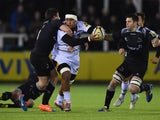 Nathan Hughes of Wasps is tackled by Adam Powell of Newcastle Falcons during the Aviva Premiership match between Newcastle Falcons and Wasps at Kingston Park on February 20, 2015