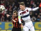 Olexandr Kucher of Shakhtar Donetsk battles with Bayern Munich's Bastian Schweinsteiger on February 17, 2015
