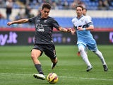 Palermo's Argentinian forward Paulo Dybala shoots and scores a goal during the Italian Serie A football match between Lazio and Palermo on February 22, 2015