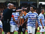 Joey Barton of QPR reacts as he is sent off by referee Anthony Taylor during the Barclays Premier League match between Hull City and Queens Park Rangers at KC Stadium on February 21, 2015