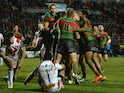 Luke Keary of South Sydney Rabbitohs (obscured) is mobbed by team mates after scoring their fifth tryduring the World Club Challenge match against St Helens on February 22, 2015
