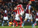Mame Biram Diouf of Stoke City celebrates scoring their first goal with Victor Moses of Stoke City during the Barclays Premier League match between Aston Villa and Stoke City at Villa Park on February 21, 2015