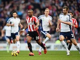 Jermain Defoe of Sunderland is callenged by Gareth McAuley of West Brom during the Barclays Premier League match between Sunderland and West Bromwich Albion at Stadium of Light on February 21, 2015