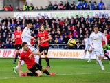 Swansea player Ki Sung-Yueng scores the first Swansea goal during the Barclays Premier League match between Swansea City and Manchester United at Liberty Stadium on February 21, 2015