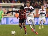Bayern Munich's Thomas Mueller takes on Luiz Adriano of Shakhtar Donetsk on February 17, 2015