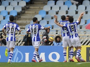 Xabi Prieto is mobbed by a herd of Real Sociedad teammates after scoring on February 22, 2015