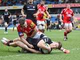 Alex Lewington of London Irish scores a try under pressure from Nick Scott of London Welsh during the Aviva Premiership match on February 28, 2015