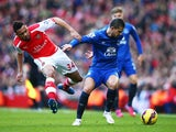 Kevin Mirallas of Everton holds off Francis Coquelin of Arsenal during the Barclays Premier League match between Arsenal and Everton at Emirates Stadium on March 1, 2015